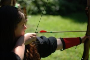 Camper shooting an arrow at Camp Sealth