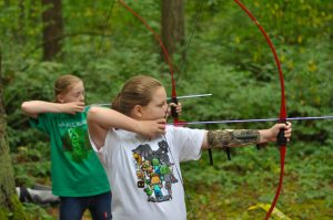 Campers shooting arrows at Day Camp