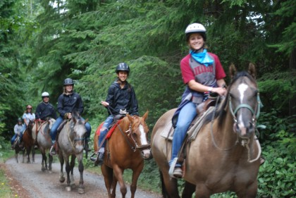 campers on trail ride horse