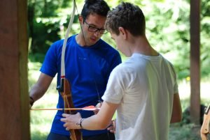 Staff teaching archery