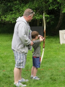Parent and child at archery