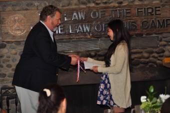 Samantha Receiving WoHeLo Award