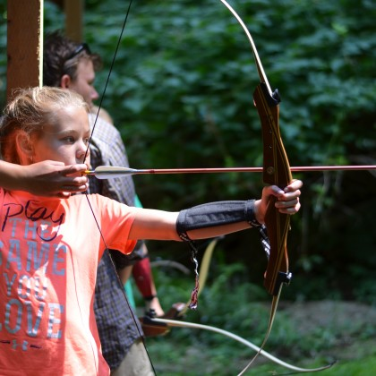 Camp shooting bow and arrow