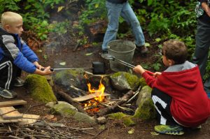 Practicing cooking in the outdoors at Tall Timbers.