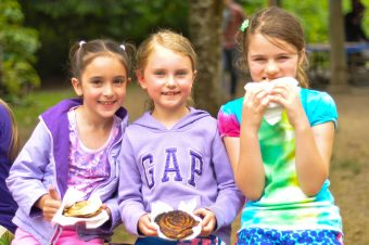 Some campers enjoying the food that they made during the outdoor cooking lesson!
