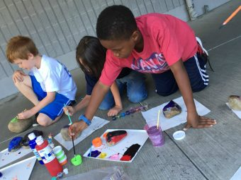 children painting rocks