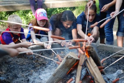 Kids around the fire at Outdoor Skills Day