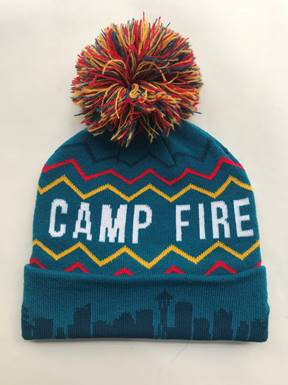 Blue Camp Fire hat with red, yellow, and blue zigzags and Seattle skyline