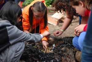 Campers learning to build a fire at Camp Sealth
