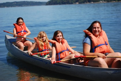 Staff and campers in canoe