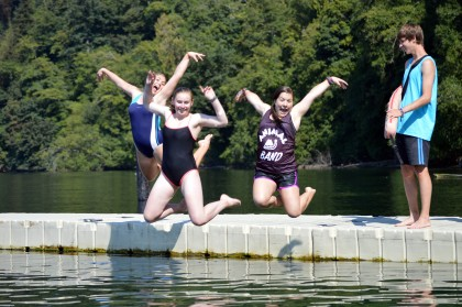 Teens jumping into water