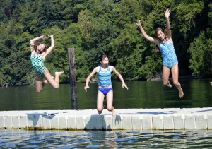 campers jumping off dock