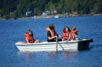 Campers and counselor in row boat