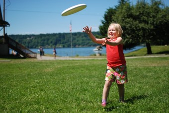 Catching a frisbee at Camp Sealth