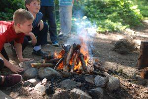 Camper building campfire