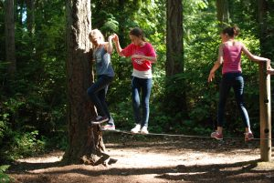 Teens on the challenge course at Camp Sealth