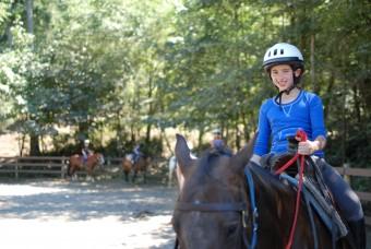 Camper riding horse