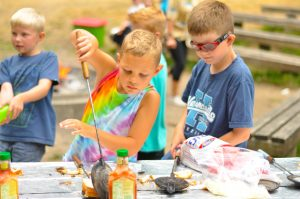 Campers cooking with pie irons at Day Camp