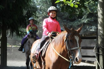 Camper on horse in pink jacket