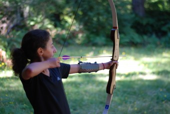 Camper at archery shooting arrow