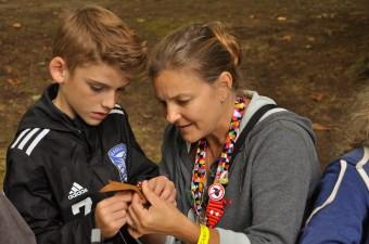 Staff helping camper at Woodland Park