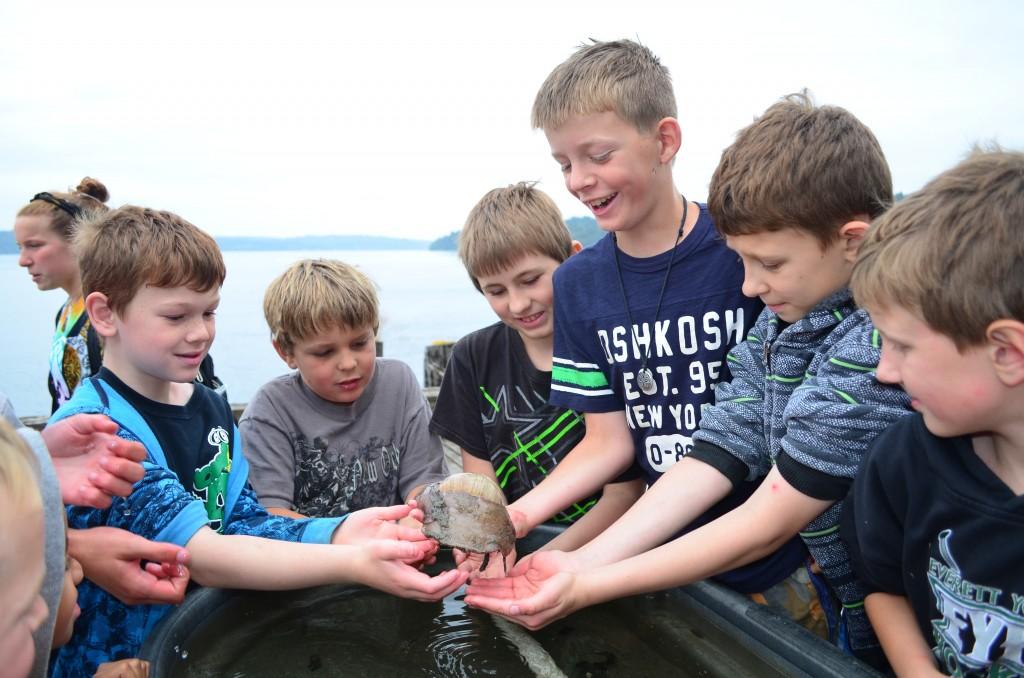 boys with sea creature